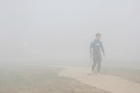 17 JUL 2005 - ASHFORD, GBR - A competitor waits for the morning mist to clear to allow the start of the Ashford Triathlon .(PHOTO (C) NIGEL FARROW)