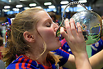 GER - Luebeck, Germany, February 07: Players of Mannheimer HC present and pose with the trophy after winning the Deutsche Meisterschaft during the prize giving ceremony at the Final 4 on February 7, 2016 at Hansehalle Luebeck in Luebeck, Germany. (Photo by Dirk Markgraf / www.265-images.com) *** Local caption *** Laura Bassemir #25 of Mannheimer HC, drinks out of the trophy