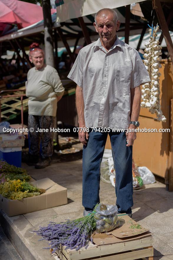Male stallholder, selling lavender, in the daily market, Zadar, Croatia.