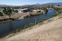 The race cource of the World Famous Suicide Race at the Omak Stampede includes a steep slope, a swim across the Okanogan River, up a short path to the arena, in Omak, Wash. on August 16-17, 2015. (photo © Karen Ducey)