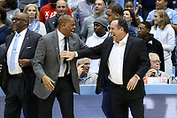 CHAPEL HILL, NC - NOVEMBER 06: University of North Carolina assistant coach Hubert Davis and University of Notre Dame head coach Mike Brey share a laugh during a game between Notre Dame and North Carolina at Dean E. Smith Center on November 06, 2019 in Chapel Hill, North Carolina.