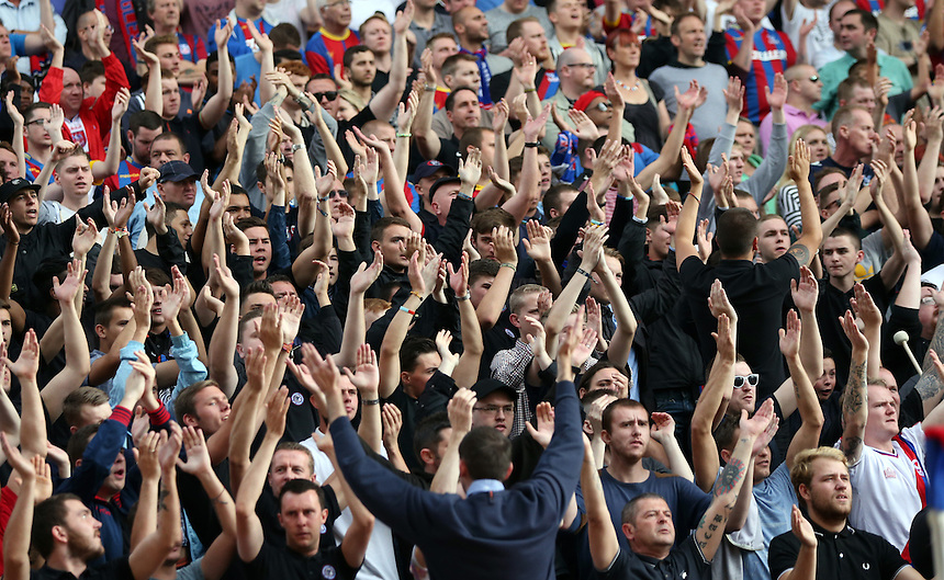 Crystal Palace's Fans<br /> <br /> Photographer Kieran Galvin/CameraSport<br /> <br /> Football - Barclays Premiership - Crystal Palace v Burnley - Saturday 13th September 2014 - Selhurst Park - London<br /> <br /> &copy; CameraSport - 43 Linden Ave. Countesthorpe. Leicester. England. LE8 5PG - Tel: +44 (0) 116 277 4147 - admin@camerasport.com - www.camerasport.com