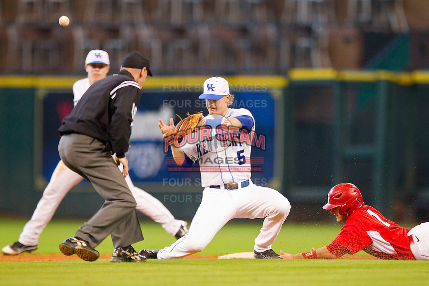 Shortstop Taylor Black #5 of the Kentucky Wildcats can't handle the throw as Landon Appling #1 of the Houston Cougars slides head first into second base at Minute Maid Park on March 5, 2011 in Houston, Texas.  Photo by Brian Westerholt / Four Seam Images