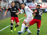 WASHINGTON, DC - MARCH 07: Edison Flores #10 of DC United tackles Ben Sweat #22 of Inter Miami during a game between Inter Miami CF and D.C. United at Audi Field on March 07, 2020 in Washington, DC.