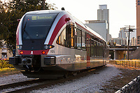 Capital MetroRail train speeds out of downtown headed east bound to the Plaza Saltillo commuter rail station in East Austin, Texas.