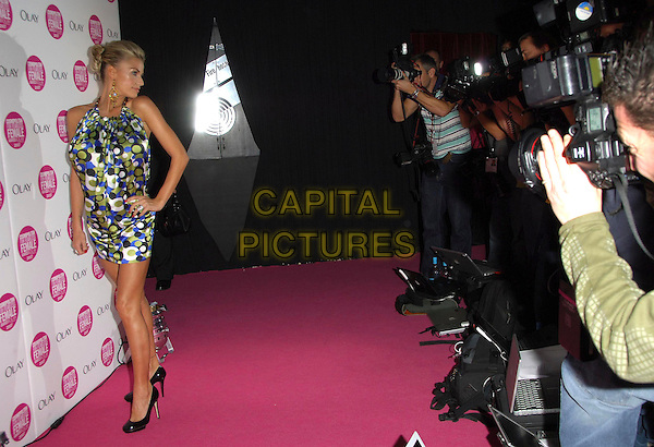 KATIE PRICE - JORDAN .Arrivals - Cosmopolitan Fun Fearless Female Awards 2007 held at Cirque, Leicester Square, London, England, November 6th 2007..full length black blue and green spot patterned print dress  halterneck photographers hand on hip.CAP/CAS.©Bob Cass/Capital Pictures.