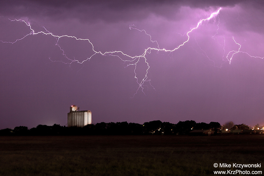 Lightning above a grain silo at night in Kansas