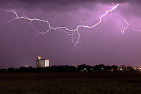 Lightning above a grain silo at night in Kansas