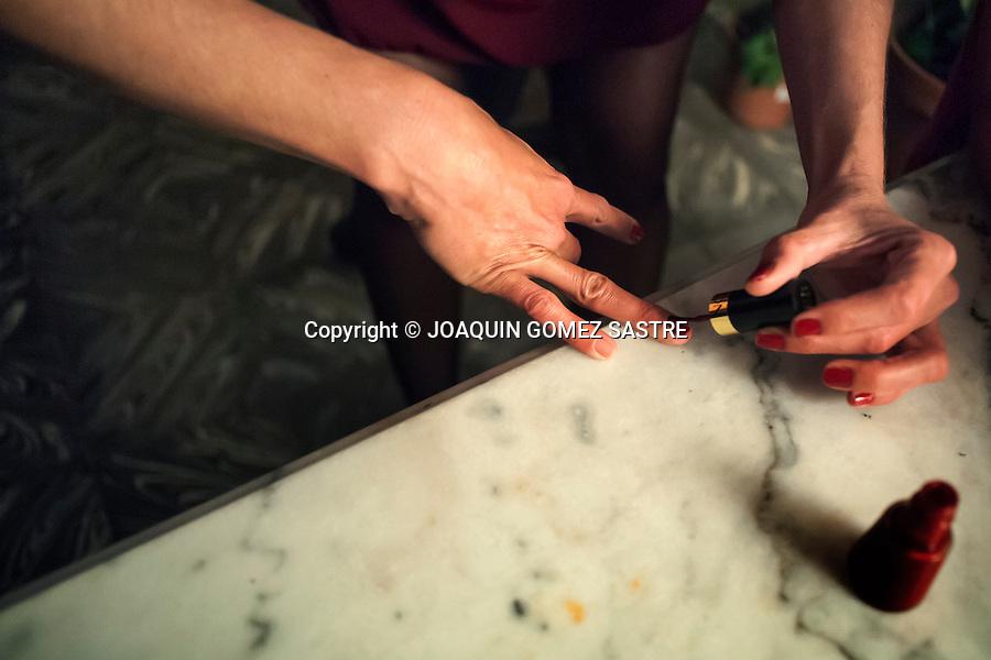A dancer paints nails before a concert held in local Pe&ntilde;a Friends of Tango Association <br />  PHOTO &copy; JOAQUIN GOMEZ  SASTRE