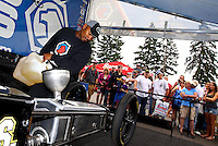 Aug. 4, 2013; Kent, WA, USA: NHRA top fuel dragster driver Antron Brown pours fuel into his car in the pits prior to the Northwest Nationals at Pacific Raceways. Mandatory Credit: Mark J. Rebilas-USA TODAY Sports