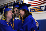 As the class is asked to line up, seniors Haylie Yeats, Rebecca Landry and Ruthanne Hay, hug, prior to the Rockville High School graduations ceremony, Wednesday, June 9, 2016, at the high school in Vernon. (Jim Michaud / Journal Inquirer)