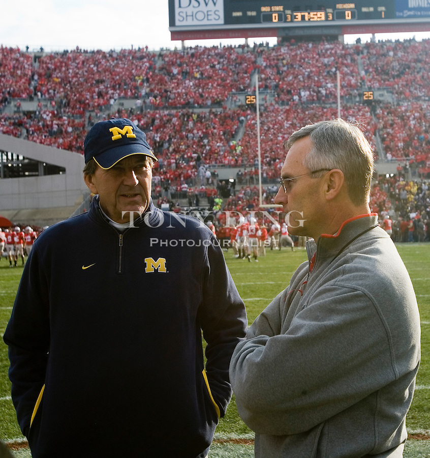 18 Nov 2006: Michigan head coach Lloyd Carr, left, shares words with Ohio State head coach Jim Tressel, before the start of Ohio State's 42-39 win over Michigan in a college football game at Ohio Stadium in Columbus, OH.