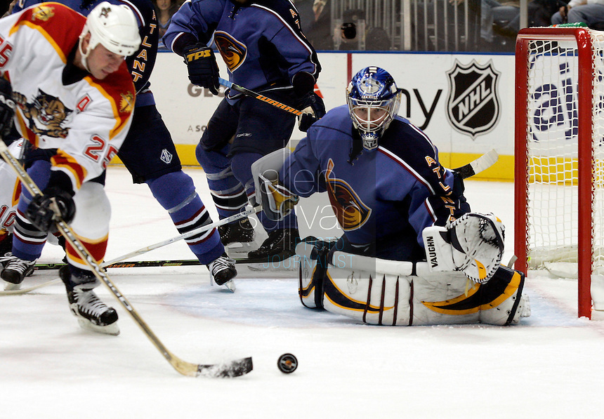 Atlanta Thrashers goalie Kari Lehtonen blocks a shot by Florida Panthers center Joe Nieuwendyk in the second period at Philips Arena. The Thrashers won the game 1-0.<br />