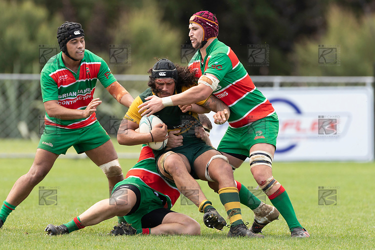 Callum Adams gets tackled by Alamoti Funaki, Michael Raaymakers and Michael McKeg. Counties Manukau Premier Club rugby game between Pukekohe and Waiuku, played at Colin Lawrie Fields, Pukekohe on Saturday April 14th, 2018. Pukekohe won the game 35 - 19 after leading 9 - 7 at halftime.<br /> Pukekohe Mitre 10 Mega -Joshua Baverstock, Sione Fifita 3 tries, Cody White 3 conversions, Cody White 3 penalties.<br /> Waiuku Brian James Contracting - Lemeki Tulele, Nathan Millar, Tevta Halafihi tries,  Christian Walker 2 conversions.<br /> Photo by Richard Spranger
