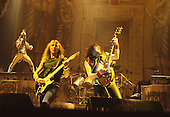 IRON MAIDEN - L-R: Bruce Dickinson, Dave Murray, Adrian Smith - performing live on the World Slavery Tour at the Odeon Hammersmith in London - 08 Oct 1984.  Photo credit: George Bodnar Archive/IconicPix