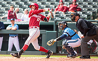 Rhode Island vs Arkansas Razorbacks Men's Baseball – Luke Bonfield of Arkansas hits one to deep left field to leave two men on at Baum Stadium, Fayetteville, AR, Sunday, March 12, 2017.  © 2017 David Beach