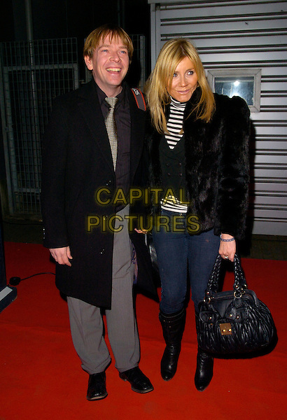"ADAM WOODYATT & MICHELLE COLLINS.Attending the ""Doctor Who"" Christmas Special Gala Screening held at the Science Museum,.London, England, December 19th 2007..full length black coat jacket bag boots.CAP/CAN.©Can Nguyen/Capital Pictures"