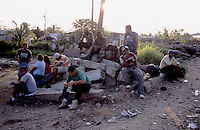 Inmigrants from Central America in Chiapas, Southern Mexico, before boarding a train in their attempt to reach the US border. They are the poorest persons among the inmigrants, they got to Mexico walking from Honduras, Guatemala or Nicaragua. Once in Mexico they can rest in shelters run by catholic priests before facing the dangerous train travel. In this step, they are often abused by police and gangs that steal the men and rape the women..Migrantes esperan el tren en las vías de la ciudad de Coatzacoalcos, Veracruz, para continuar su viaje hacia la frontera norte de México.