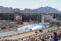 Apr. 5, 2009; Las Vegas, NV, USA: NHRA funny car drivers Matt Hagan (left) and Bob Bode do their burnouts during the first round of eliminations of the Summitracing.com Nationals at The Strip in Las Vegas. Mandatory Credit: Mark J. Rebilas-