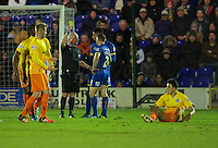 Lyle Taylor of AFC Wimbledon is shown the yellow card by Referee Philip Gibbs after he picks up Luke O'Nien of Wycombe Wanderers and throws him to the ground during the Sky Bet League 2 match between AFC Wimbledon and Wycombe Wanderers at the Cherry Red Records Stadium, Kingston, England on 21 November 2015. Photo by Alan  Stanford/PRiME.