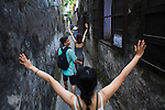 People in an alley. Hoi An, Vietnam. April 15, 2016.
