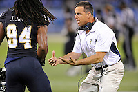 20 December 2011:  FIU Head Football Coach Mario Cristobal fires up defensive lineman James Jones (94) prior to the game.  The Marshall University Thundering Herd defeated the FIU Golden Panthers, 20-10, to win the Beef 'O'Brady's St. Petersburg Bowl at Tropicana Field in St. Petersburg, Florida.