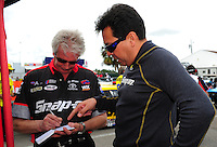 Mar. 9, 2012; Gainesville, FL, USA; NHRA funny car driver Cruz Pedregon (right) and crew chief Lee Beard during qualifying for the Gatornationals at Auto Plus Raceway at Gainesville. Mandatory Credit: Mark J. Rebilas-