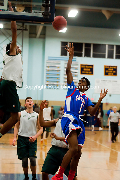 WATERBURY, CT--- -121915JS17--Crosby's Roary Judusingh (1) puts up a shot only to have it blocked by Holy Cross' Deandre Wallace (24) during the annual boys basketball jamboree held Saturday at Kennedy High School in Waterbury, <br /> Jim Shannon Republican-American
