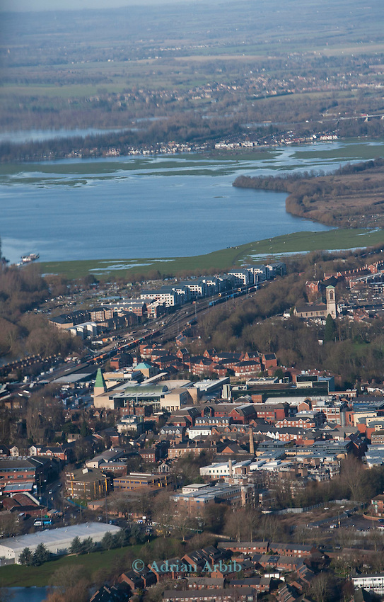 The  Thames, Oxford in  flood . <br /> View  North towards Wolvercote  and Portmeadow a natural flood plain ( LHS top) .  The controversial University buildings  of Roger Dudman Way  can  be seen ( centre)  along rialiway lines.