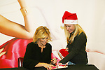 "Country Singer Faith Hill promotes her Christmas cd ""Joy To The World"" on November 24, 2008 at Virgin Magastore in Times Square, NYC, NY. Fan gives Faith a Santa Hat. (Photo by Sue Coflin/Max Photos)"