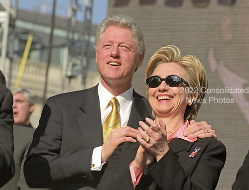 United States President Bill Clinton and first lady Hillary Rodham Clinton watch an elite military paratrooper show during the Opening Ceremonies of America's Millennium Celebration in Washington, D.C. on December 31, 1999.<br /> Credit: Ron Sachs / CNP