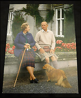BNPS.co.uk (01202 558833)<br /> Pic: MooreAllen&amp;Innocent/BNPS<br /> <br /> The Queen and Prince Philip with one of the royal corgis on a card from 1990.<br /> <br /> A comprehensive collection of Christmas cards sent by the Queen and Prince Philip over a 30 year period have emerged to highlight the fascinating changes of the Royal Family.<br /> <br /> The 31 greetings cards carry various images of the Royal couple on the front along with different members of their family.<br /> <br /> They were sent every year without fail from 1971 through to 2001 to the unnamed recipient, who was clearly an acquaintance of the Queen.<br /> <br /> The first card features a formal photograph of the Queen, the Duke of Edinburgh, a 23-year-old Prince Charles, Princess Anne, Prince Andrew, aged 11 and seven-year-old Prince Edward.<br /> <br /> They are being sold in Cirencester on Friday.