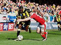 Burton Albion v Barnsley 16.4.16 .Sky Bet League 1 ....... Burtons Lucas Akins holds off Barnsl;eys George Williams