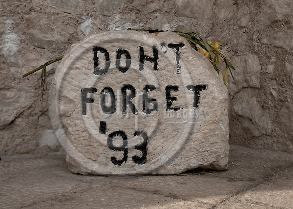 """BOSNIA - MOSTAR 18. NOVEMBER 2006 -- A memorial stone """"Don¥t forget ¥93"""" at the old bridge """"Stari Most"""" the landmark of Mostar - destroyed by croat grenades during the bosnian civil war in 1993 - rebuilt 2004  -- PHOTO: CHRISTIAN T. JOERGENSEN / EUP & IMAGES..This image is delivered according to terms set out in """"Terms - Prices & Terms"""". (Please see www.eup-images.com for more details)"""