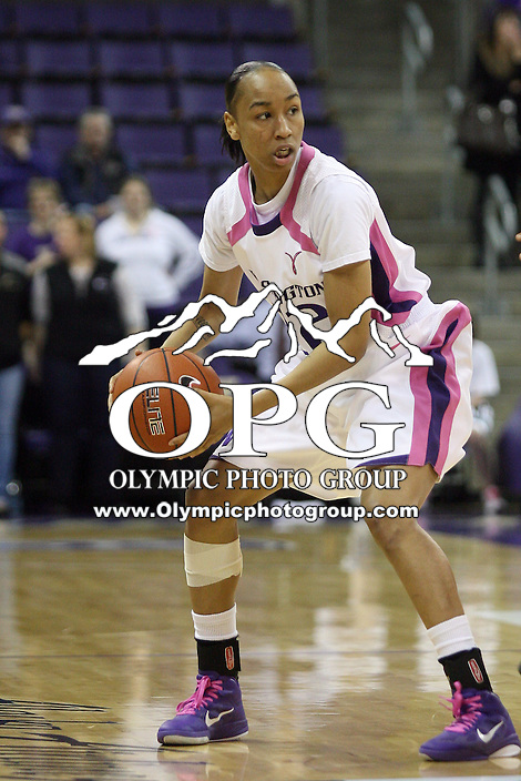 February 17, 2011:  Washington Huskies guard #22 Charmaine Barlow looks for an open teammate to pass the ball to against Arizona State.  Arizona State defeated Washington 71-63 at the Hec Ed Arena in Seattle, WA.