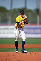 Michigan Wolverines starting pitcher Tommy Henry (47) gets ready to deliver a pitch during a game against Army West Point on February 17, 2018 at Tradition Field in St. Lucie, Florida.  Army defeated Michigan 4-3.  (Mike Janes/Four Seam Images)