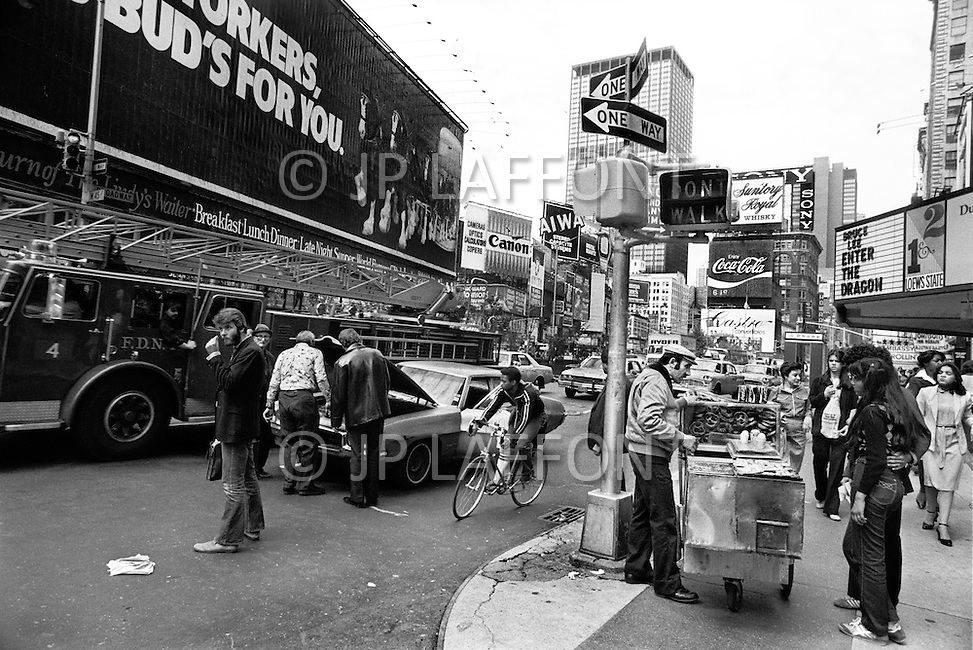 Manhattan, New York City, NY. May, 1980.<br /> Street at Time Square. Times Square had acquired a reputation as a dangerous neighborhood during the 1980's.  The shabiness of the area, especially due its go-go bars, sex shops, and adult theaters, became an infamous symbol of the city's decline.