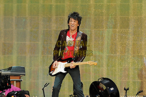 Ronnie Wood of The Rolling Stones <br /> performing at Barclaycard British Summertime, Hyde Park, London, England, UK, <br /> 13th July 2013.<br /> music concert gig festival live on stage  half length playing guitar brown suede biker jacket red t-shirt <br /> CAP/MAR<br /> &copy; Martin Harris/Capital Pictures