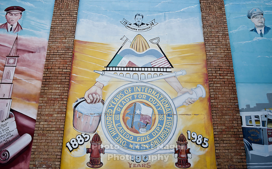 A mural celebrating the intertwined history of the Mexican and US cities of Nuevo Laredo and Laredo on the back wall of a fire station in Laredo, Texas, US, Wednesday, Dec., 9, 2009. Laredo's population and proximity to Mexico makes it strongly Spanish speaking with over 95% being Hispanic...PHOTOS/ MATT NAGER