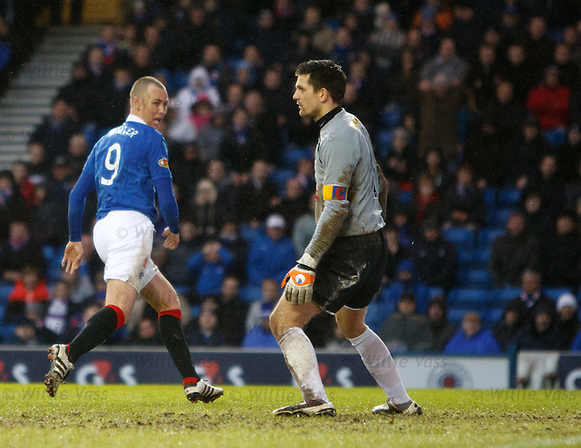 Kenny Miller dinks in the ball from Vladimir Weiss' shot to score goal no 3 for Rangers and runs to celebrate