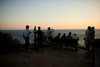 Tourists enjoy a view of the sea from Giardini di Augusto at sunset on Monday, Sept. 21, 2015, on the island of Capri in Italy. (Photo by James Brosher)