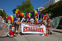 Group wearing rainbow color feather Headdresses, Seattle Pride Parade 2016, Washington, USA.