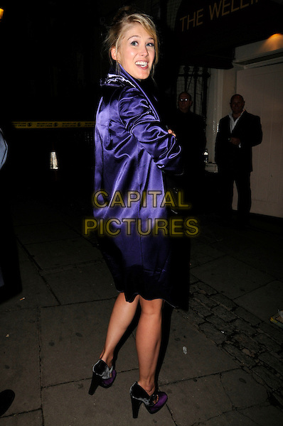 ROSAMUND PIKE .The Serpentine Gallery Summer Party after party at the Wellington Club, London, England..September 9th, 2008.full length purple silk satin jacket looking over shoulder shoes .CAP/ADM/SW.©SWCapital Pictures.