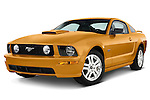 Low aggressive front three quarter view of a 2007 orange Frod Mustang