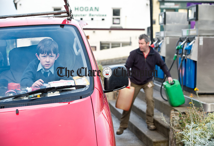 The Waiting game...Young Ronan Murray waits in the van for his dad Flan Murray as he collects fuel at Rodgers in Scariff. Photograph by John Kelly.