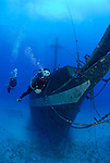Diver swimming close to the bow of the carthaginian wreck of the west shore of Maui, Hawaii.90 feet deep.