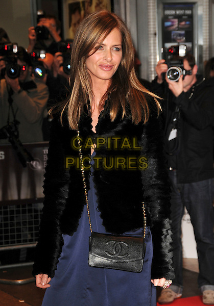 "TRINNY WOODALL .arrives at the premiere of ""Anvil! The Story Of Anvil"" during the Times BFI 52nd London Film Festival, at the Odeon West End, London, England, .October 21, 2008..half length black fur coat jacket blue dress Chanel bag cross body chain strap .CAP/CAS.©Bob Cass/Capital Pictures"