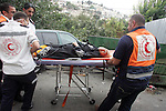 Palestinian medics evacuate an injured woman from the Al-Aqsa mosque compound in Jerusalem's Old City during the clashes in the east Jerusalem neighborhood of Silwan, Wednesday, Sept. 22, 2010. Violence erupted after a 32-year-old Palestinian laborer was killed by a private security guard watching over Jewish families in the Silwan neighborhood in east Jerusalem. During the man's funeral, a mob of protesters set tires on fire, smashed the windows of several buses and called for revenge. Photo by Mahfouz Abu Turk