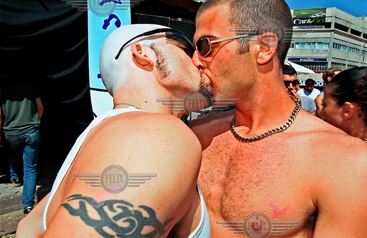 Gay men kissing during an after-party at Haoman 17 night club.