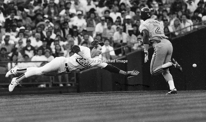 Carney Lansford dives for ball. (1988 photo by Ron .Riesterer)